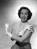 Jane Wyman Portrait in White Short Sleeve Silk Dress and Linen Tweed Skirt with Arms Crossed with G