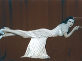 Joan Bennett Lying Pose in White Dress