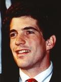 John Kennedy wearing a Black Suit in a Close Up Portrait