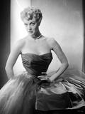 Jan Sterling Portrait in Black Velvet Dress with Sheer Silk Skirt while Hands on the Waist