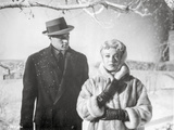 Imitation Of Life Lady in Furry Coat with Man in Black Suit with Hat