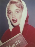 Jane Powell Close Up Portrait in Red Velvet Hood and Gloves with Eyes Looking Up and Mouth Opened