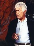 James Coburn Posed in Black Coat