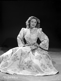 Joan Blondell on Printed Dress and sitting