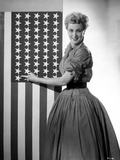 Jan Sterling Posed Facing the Right in Velvet Dress with Rolled Up Sleeves and Pleated Skirt while