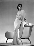 Jean Parker Posed in White Broad Sleeve Silk Dress and Fishtail Skirt with Left Hand on the Top Rai