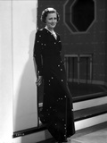 Irene Dunne on Black Long Dress Leaning on Wall