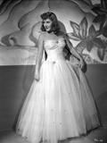 Jean Arthur Posed in White Strapless Silk Dress with Pleated Sheer Skirt with Head Turn to the Righ