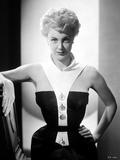 Jan Sterling Portrait in White Collar Neck Strap Black Velvet Shoulder Dress with Left Hand on the