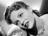 Joan Leslie on a Necklace Lying and posed