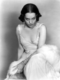 Lupe Velez sitting in White Dress with Earrings