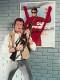 Marc Singer Posed in Leather Vest with Rifle Portrait