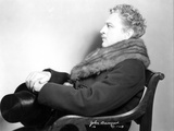 John Barrymore sitting on a Chair wearing a Scarf