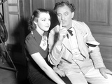 John Barrymore sitting with a Woman in a Classic Portrait