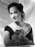 Merle Oberon on an Off Shoulder Dress with Flower