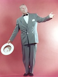 Maurice Chevalier Posed in Red Background