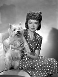 Lillian Gish on a Polka Dotted Dress sitting with a Dog