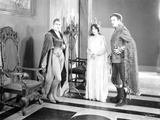 John Barrymore standing in Tights and Cape