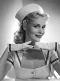 Marie Wilson Posed in White Sailor Dress with Hands on Chin