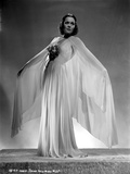 Jane Wyman Posed in White V-Neck Gathered Silk Bodice and Pleated Silk Skirt with Long Sheer Silk M