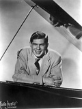 Johnnie Ray Leaning on Piano