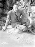 John Barrymore Seated on Rocks