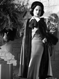 Merle Oberon Posed in Furry Coat with Ribbon