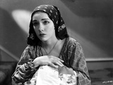 Lupe Velez Posed in Checkered Dress with Black Scarf on Her Head