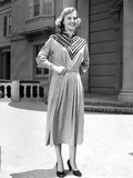 Lola Albright smiling in a Dress and Black Shoes  and Hands on Waist