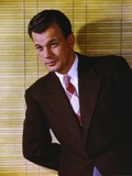 Joseph Cotten wearing Black Suit with Necktie