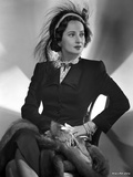 Merle Oberon on a Long Sleeve sitting