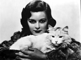 Margaret Sullivan Posed in Fur Dress with Cat