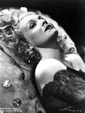Madeleine Carroll Lying in Black Dress with Curly Hairstyle
