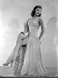 Mary Martin on an Embroidered Dress sitting and Leaning Portrait