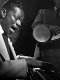 Nat Cole Playing Piano While singing