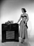 Jane Wyman Posed in White Silk Strapless Dress with Black Fur Belt Around and Below the Waist