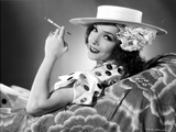 Lupe Velez smiling in polka dot while Holding a Cigarette