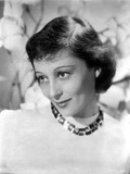 Luise Rainer Chin Down Pose with a Necklace