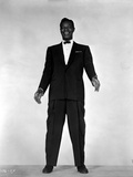 Nat Cole standing in Black Suit With White Background
