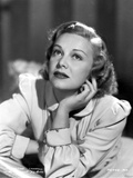 Madeleine Carroll Looking up in White Dress with Head Leaning on Hand