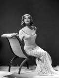 Lizabeth Scott Seated in Chair wearing Long Gown