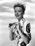 Ida Lupino Posed in a Printed Dress with Sun Glasses
