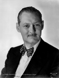 Lionel Barrymore Posed in Black Suit with Polkadot Bowtie in Classic Portrait