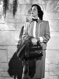 Merle Oberon wearing Coat with Bag and Fur jacket
