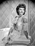 Mary Martin on an Embroidered Dress smiling and sitting