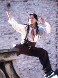 Jackie Chan Posed in Red Scarf
