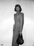 Jane Wyman Posed in Grey Linen Long Sleeve Tweed Suit Dress and Long Skirt with Right Hand Holding