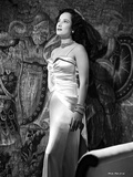 Merle Oberon standing a Silk Gown