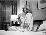 Jean Simmons Seated on the Bed in White Long Sleeve Sleep Dress
