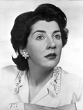 Maureen Stapleton Portrait wearing White Printed Blouse with Flower Earrings